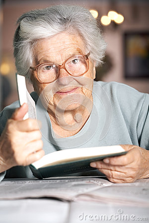 Free Elderly Lady With A Book Royalty Free Stock Photography - 3932037