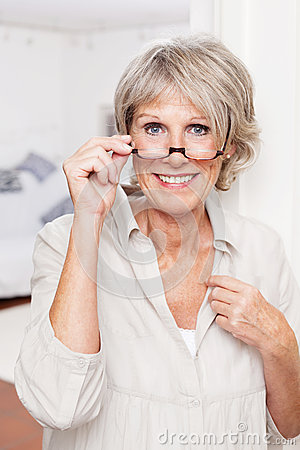 Free Elderly Lady With Reading Glasses Royalty Free Stock Images - 31225869