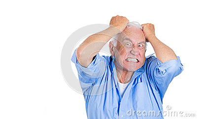 Elderly mad, crazy looking, desperate man, pulling out his hair,