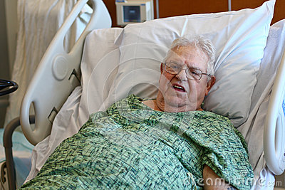 Elderly male hospital patient is happy