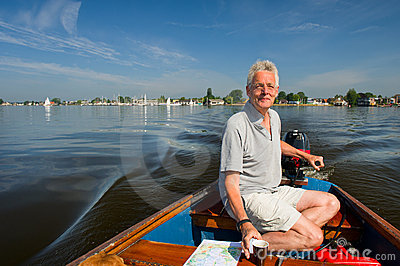 Elderly man in boat