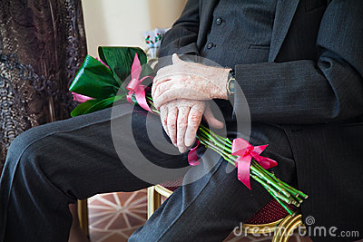 Elderly man with bouquet