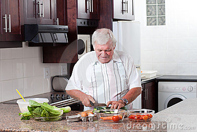 Elderly man cooking