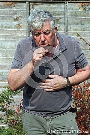 Elderly man coughing.