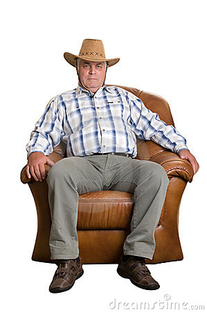 An elderly man in cowboy hat sitting in the chair