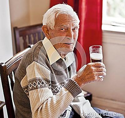 Elderly man with a drink