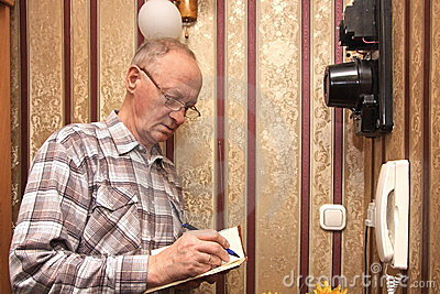 An elderly man electric meter