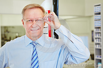 Elderly man with glasses at