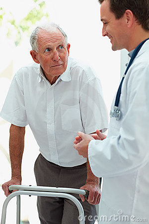 Elderly man having a casual talk with a doctor
