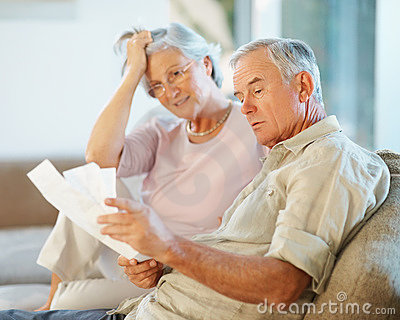 Elderly man with his wife going through documents