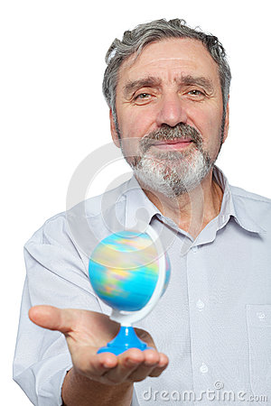 Elderly man holds small globe in his hand