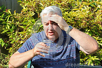 Elderly man ill drinking water.