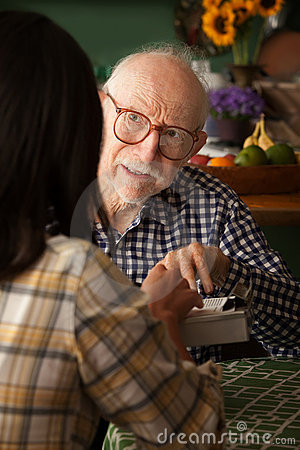 Free Elderly Man In Home With Provider Or Survey Taker Royalty Free Stock Images - 16549249
