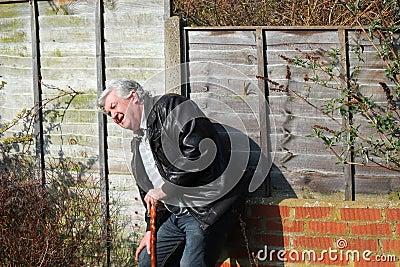 Elderly or old man feeling ill.