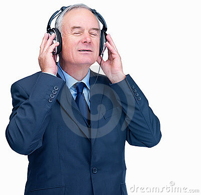 Elderly man listening to music over headphones