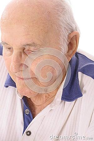 Elderly man looking down depressed