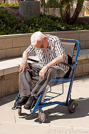 Elderly man in modern wheelchair