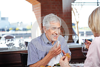 Elderly man with napkin at
