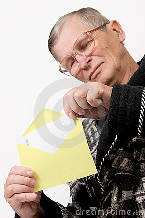 Elderly man opening letter envelope