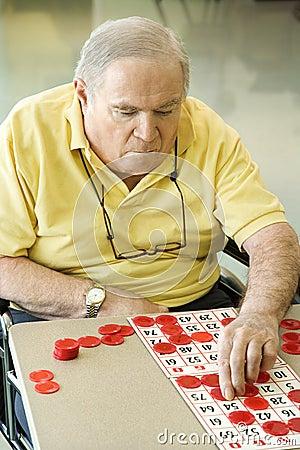 Free Elderly Man Playing Bingo. Royalty Free Stock Images - 2044409