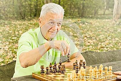 Elderly man playing chess