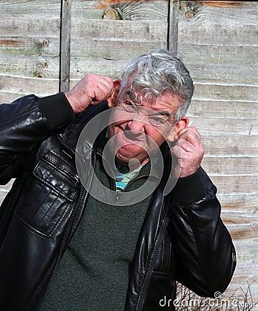Elderly man pulling a funny face.