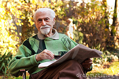 Elderly man reading the paper