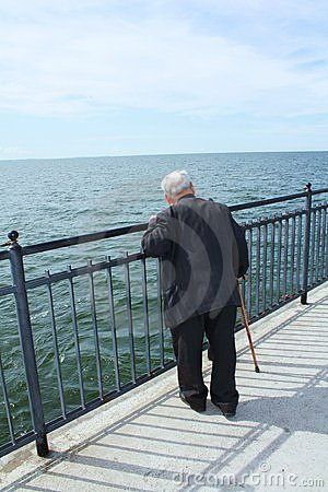 Elderly man by the sea