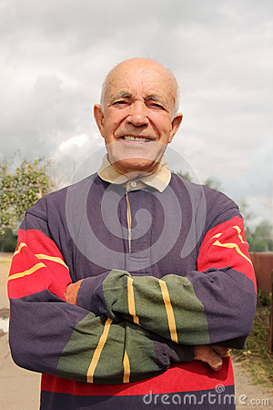 An elderly man smiling in the sun