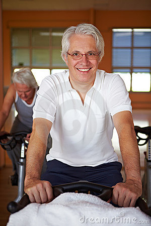 Elderly man on spinning bike