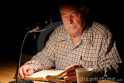 Elderly man studying the Bible