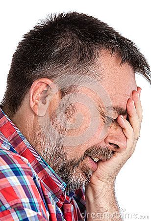 Elderly man suffering from a headache