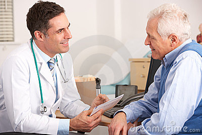 Elderly man talking with an American doctor