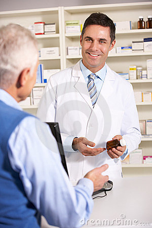 Elderly man talking with American pharmacist