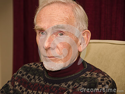 Elderly man in thoughtful mood