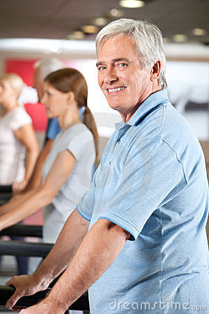 Elderly man on treadmill in gym