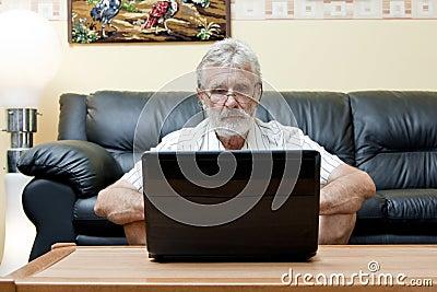 Elderly man using computer