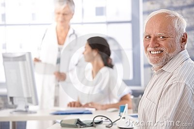 Elderly man waiting for examination smiling