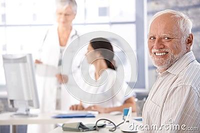 Elderly man waiting for examination smiling