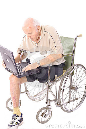 Elderly man in wheelchair on laptop vertical