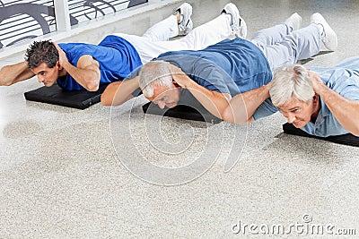 Elderly men doing back exercises