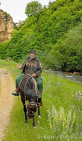 An elderly mountain dweller on horseback Editorial Stock Image