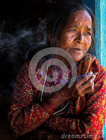 Free Elderly Nepali Woman Smoking Stock Images - 108857814