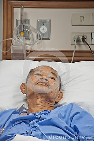 Elderly patien in hospital lay on the bed
