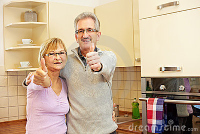 Elderly people holding thumbs up