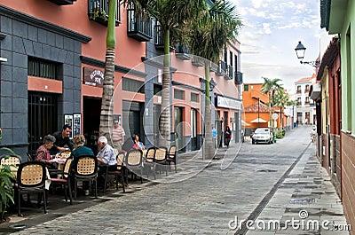 Elderly people in street restaurant