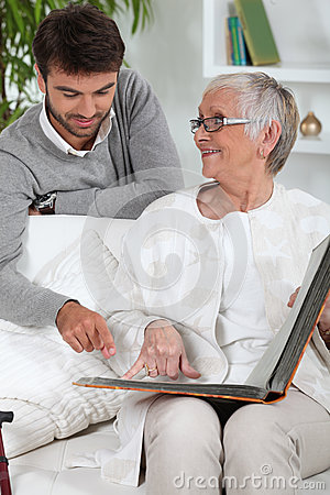 Elderly person looking at photos