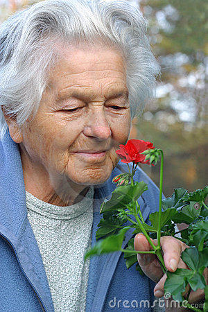 Free Elderly Person With A Flower. Stock Image - 495671
