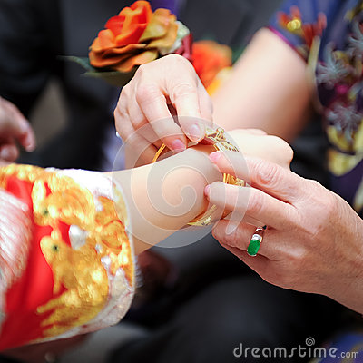 Elderly relatives presenting the golden bracelet