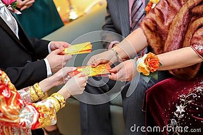 Elderly relatives presenting the red pocket
